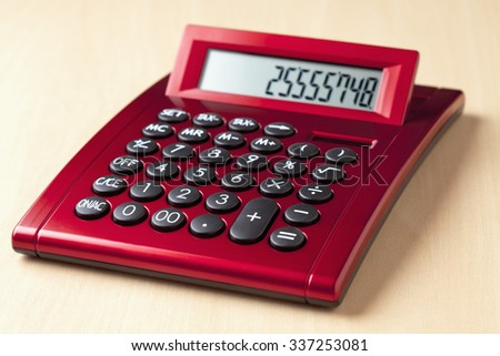 Red calculator - stock photo