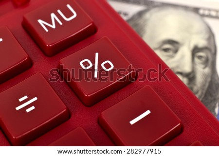 red calculator and dollar banknote, close up - stock photo