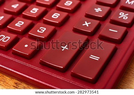 Red Calculator on table, extra close up - stock photo