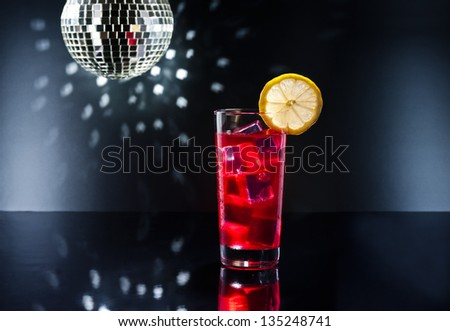 Red Campari cocktail cocktail in Disco setting - stock photo