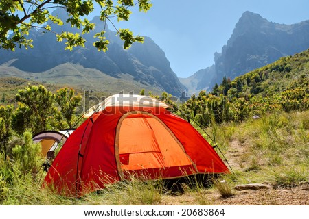 Red camping tent in misty mountains. Shot in Hottentots-Holland Mountains nature reserve, near Somerset West/Cape Town, Western Cape, South Africa. - stock photo