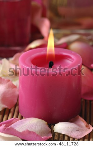 Red Candle and red Roses petals
