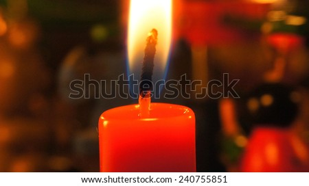 Red candle closeup, Christmas - stock photo