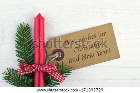 red candle, fire branch and christmas card/best wishes for christmas and New Year/english