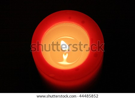 red candle with black background (view from top) - stock photo