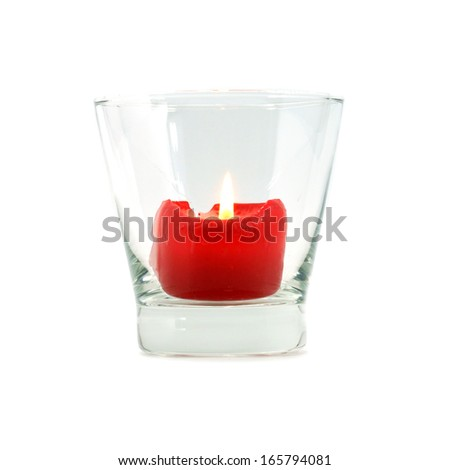 Red candles in glass tableware. - stock photo