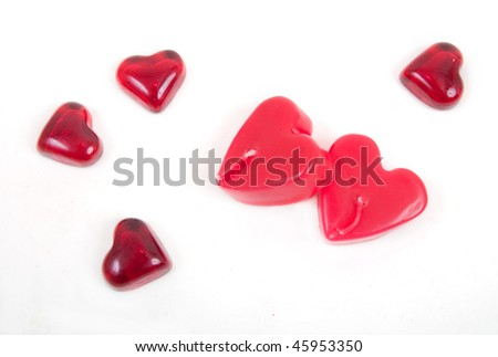 red candles in shape of heart isolated on white