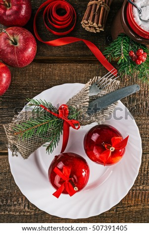 Red candy apples and christmas decorations on the wooden table