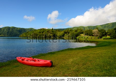 Red Canoe on Azores lagoon, in the amazing island of Sao Miguel.All this natural beauty makes it one of the top vacation destinations in Portugal. - stock photo