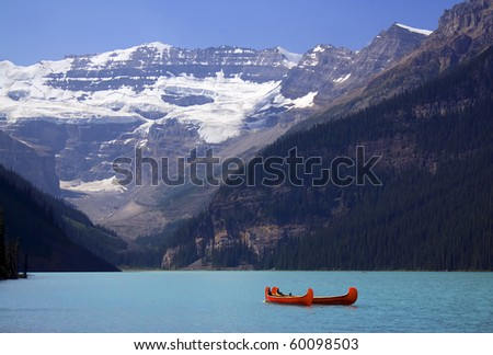 Red Canoe on Lake Louise, Banff National Park, Alberta, Canada - stock photo