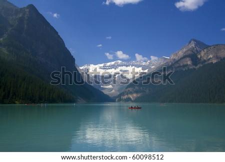 Red Canoe on Lake Louise, Banff National Park, Alberta, Canada - stock photo