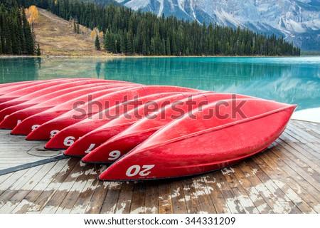 Red Canoes at Emerald Lake, Yoho National Park, British Columbia, Canada - stock photo