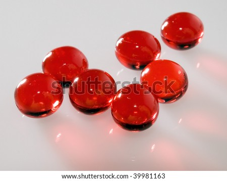 Red capsules. - stock photo