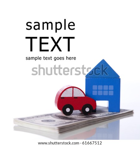 red car and blue house over a lot of dollar bills isolated on white  (selective focus) - stock photo