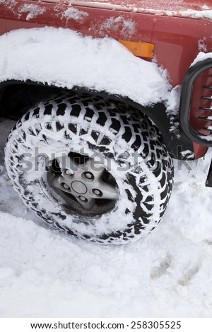 Red car covered with snow, Winter storm - stock photo