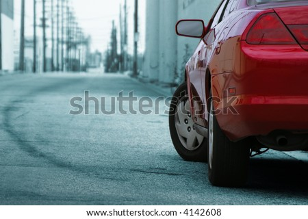 Red car detail. Los Angeles street behind. - stock photo