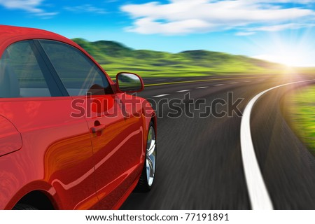 Red car driving by autobahn in sunset with motion blur - stock photo