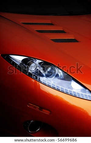 Red Car headlight - stock photo