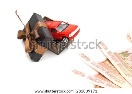 red car in brown gift box and banknotes on white - stock photo