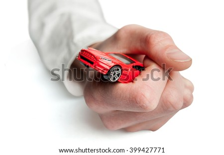 Red car in the men's hands on a white background. Car insurance. Automobile collision damage waiver concepts. with protective gesture and icon of car. Protection of car. Business concept