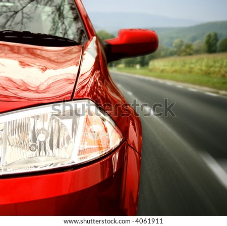 Red car on the highway