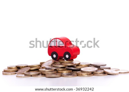 red car over a lot of golden coins (isolated on white) - stock photo