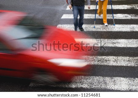 red car with a man - stock photo