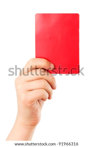 Red card in a hand in front of a white background - stock photo