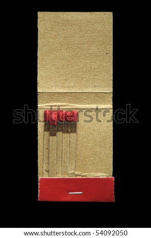 Red cardboard matchbook isolated on pure black background. - stock photo