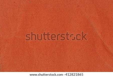 Red cardboard sheet useful as a background