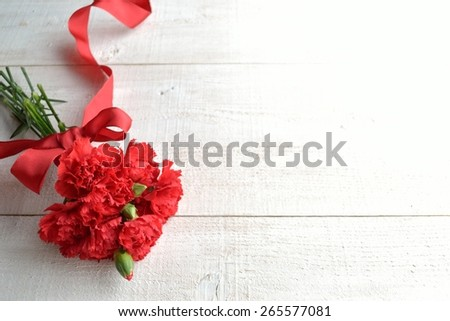 Red carnations bouquet. - stock photo