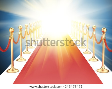 red carpet between two gold stanchions with rope and flash light - stock photo