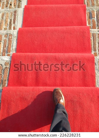 red carpet catwalk with elegant man who drops - stock photo