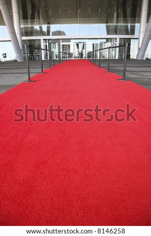 Red carpet celebrity entrance into a glass building - stock photo