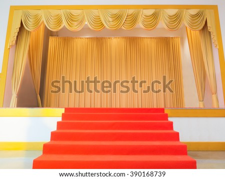 red carpet leading to the performance stage in presentation events - stock photo