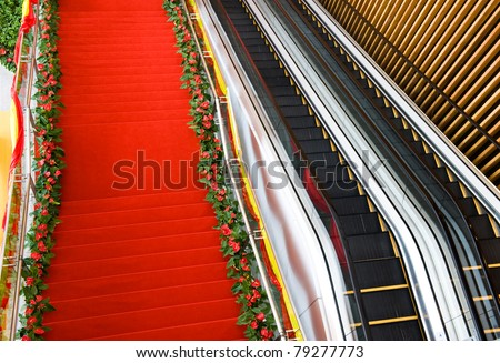 Red carpet on the steps leading to the doorway. - stock photo