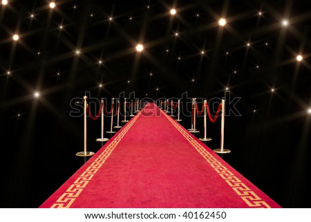 Red carpet with photographer flash - stock photo