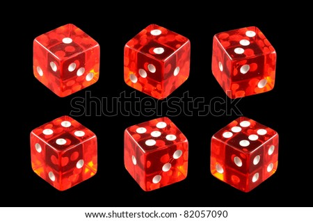 Red casino dice isolated over black background - stock photo