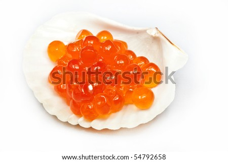 red caviar in a white cockleshell - stock photo