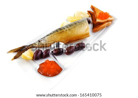 red caviar on toast and sea fish - stock photo