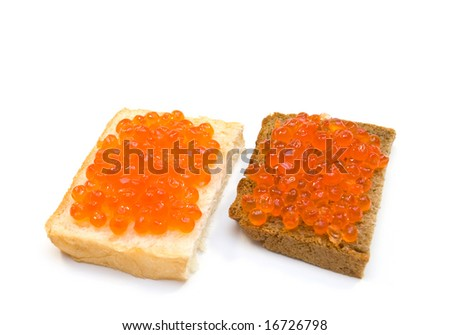red caviar on white and black bread