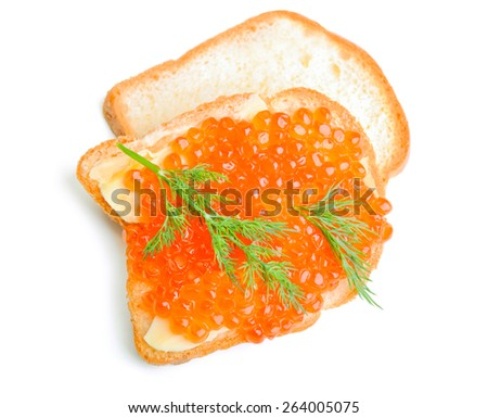 Red caviar sandwich with fresh dill, isolated on white