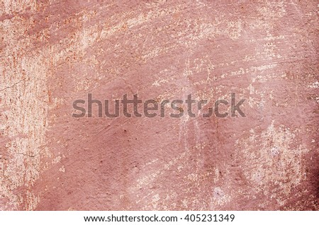 Red cement wall with traces of the brush on the crumbling plaster and small cracks. textural composition - stock photo
