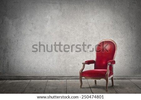 Red chair in an empty room  - stock photo