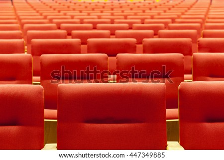 red chair in cinema room background - stock photo