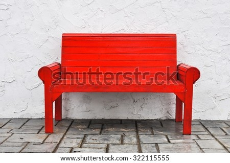 red chair on white background,red Chair wooden on white wall