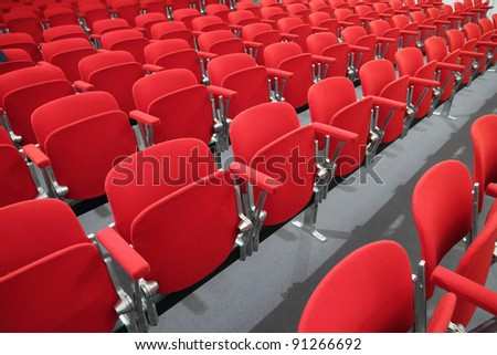 red chair seats in an empty conference room - stock photo