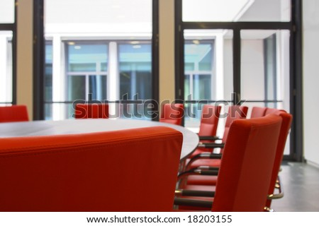 Red chairs in a board room - stock photo