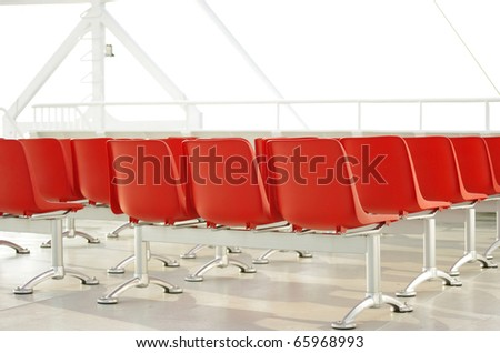 red chairs in light environment - stock photo