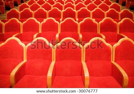 Red chairs in some theater - stock photo